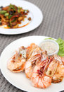 Grilled shrimps with seafood sauce on white plate Stock Photo