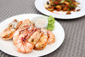 Grilled shrimps with seafood sauce on white plate Stock Photos