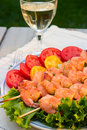 Grilled shrimps and white wine outdoor Stock Photography
