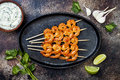 Grilled spicy lime shrimp skewers with creamy avocado garlic cilantro sauce. Top view, overhead, flat lay, copy space. Royalty Free Stock Photo