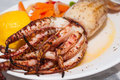 Grilled squid on plate delicious calamari Royalty Free Stock Photography