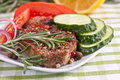 Grilled Steak Мет with rosemary and vegetables Royalty Free Stock Images