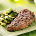 Grilled steak with brussel sprouts close up photo of a shot selective focus Royalty Free Stock Photo