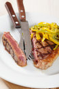 Grilled steak with pepper Stock Images