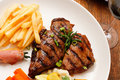 Grilled steak with red wine Stock Photography