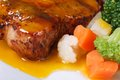 Grilled steak with sauce and vegetable garnish macro Stock Images