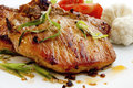 Grilled steak with spices pork chop and vegetables Stock Photo