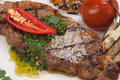 Grilled Steak with Spicy Herb Sauce Royalty Free Stock Photo