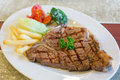 Grilled steaks with french fries Stock Image
