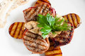 Grilled steaks and potatoes on white flat lay Royalty Free Stock Photo