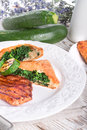 Grilled steaks with puff pastry bag and zucchini a tasty Royalty Free Stock Photo