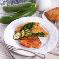 Grilled steaks with puff pastry bag and zucchini a tasty Royalty Free Stock Images