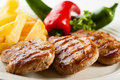 Grilled steaks with vegetables Royalty Free Stock Images
