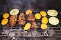 Grilled steaks and vegetables like sweet potatoes and zucchini cooked on the garden grill. Royalty Free Stock Photo