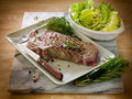 Grilled t-bone with  salad Stock Photography