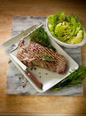Grilled t-bone with  salad Royalty Free Stock Image