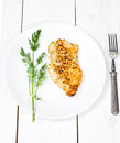 Grilled tasty chicken breasts on a white plate with fresh herbs wooden background Stock Photo