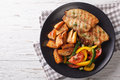 Grilled Tilapia fillet and potato wedges, fresh salad close-up. Royalty Free Stock Photo