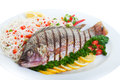 Grilled tilapia served with pasta and vegetables Stock Images