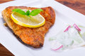 Grilled trout with lemon on the plate Stock Photography