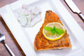 Grilled trout with lemon on the plate Stock Image