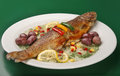 Grilled trout on plate with spices and olives Stock Images