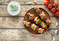 Grilled turkey or chicken meat shish kebab skewers with tzatziki Royalty Free Stock Photo