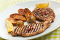 Grilled turkey fillet ,fried potatoes Stock Photo