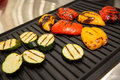 Grilled vegetables on baking sheet, red pepper and yellow pepper, zucchini