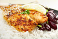 Grilled white fish with spicy rub creole or cajun served with rice red kidney beans and lime fish is dory Stock Photos