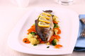 Grilled whole trout vegetables and lemon frontal Royalty Free Stock Images