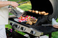 Grilling in the back yard. Royalty Free Stock Photo