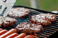 Grilling burgers and hot dogs Royalty Free Stock Photo