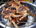 Grilling chicken barbecue in market Stock Photo