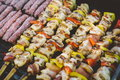 Grilling chicken meat skewers and kebab with vegetables on barbecue charcoal grill Royalty Free Stock Photo