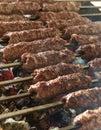Grilling kofta arabian over warm coal heat Royalty Free Stock Photo