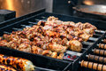 Grilling marinated shashlik preparing on a barbecue grill over charcoal. Royalty Free Stock Photo