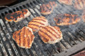 Grilling meat on barbecue grill balls Stock Photography