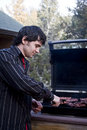 Grilling meat on the bbq Royalty Free Stock Photo
