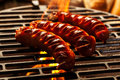 Grilling sausages on barbecue grill selective focus Royalty Free Stock Photos