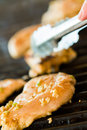 Grilling seasoned chicken for chicken fajitas Royalty Free Stock Photos