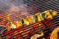 Grilling shashlik on barbecue grill. Royalty Free Stock Photo