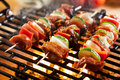 Grilling shashlik on barbecue grill selective focus Royalty Free Stock Images