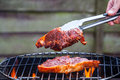 Grilling a steak on the bbq outdoors Royalty Free Stock Photo