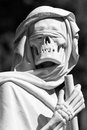 Grim reaper sculpture on monumental cemetery in italy Stock Photos