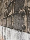 Grimy wall perspective of old brick in sunlight Royalty Free Stock Image