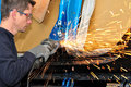 Grinding making a lot of sparks proffesional worker car body Stock Images