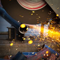 Grinding a metal plate worker Royalty Free Stock Images