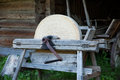 Grindstone old massive hand used to sharpen farm tools axe scythe etc Stock Photography