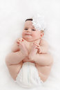 Grinning infant baby the first year of the new life Royalty Free Stock Photo